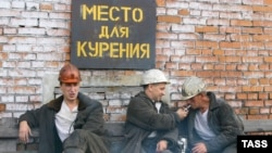 Russian miners smoke cigarettes in Kemerovo