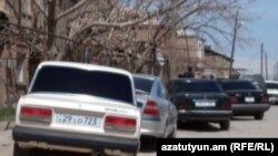 Armenia -- Cars parked outside the Armavir house of Meruzhan Mkhoyan, an election candidate allegedly beaten up by loyalists of his pro-government rival, 6Apr2012.