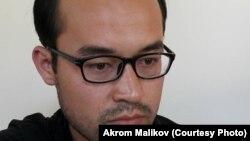 Акром Маликов.