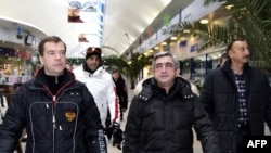 Russia -- President Dmitry Medvedev (L), with his Armenian and Azrbaijani counterparts Serzh Sarkisian (C) and Ilham Aliyev tour the Krasnaya Polyana ski resort in Sochi, 25Jan2009