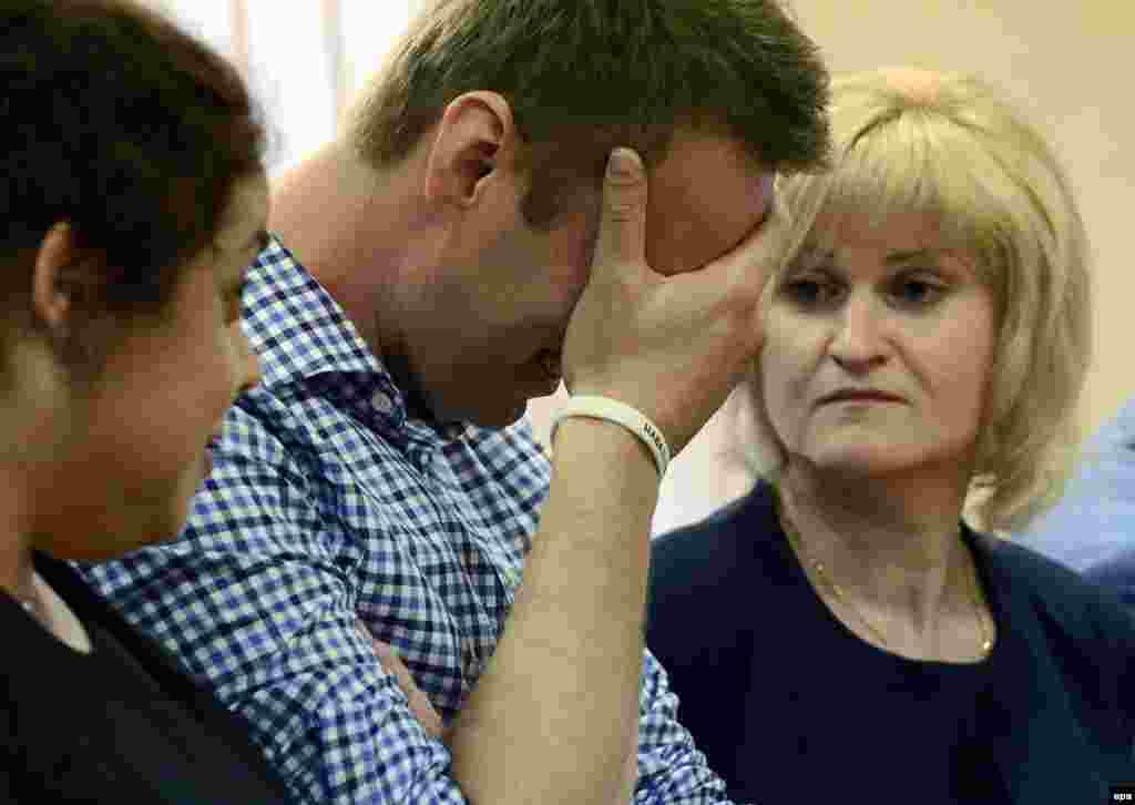 Russian opposition figure Aleksei Navalny reacts as the judge reads his sentence.