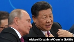 Russian President Vladimir Putin (left) and Chinese President Xi Jinping in China in June.