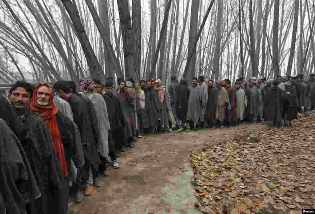 Voters line up to cast their votes outside a polling station during the first phase of of voting in state assembly elections in Jammu and Kashmir, which is administered by India, on November 25. (Reuters/Danish Ismail)