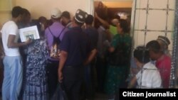 Uzbekistan - Overcrowded passport issuing department of Olot district of Bukhara region, 07Jule2014