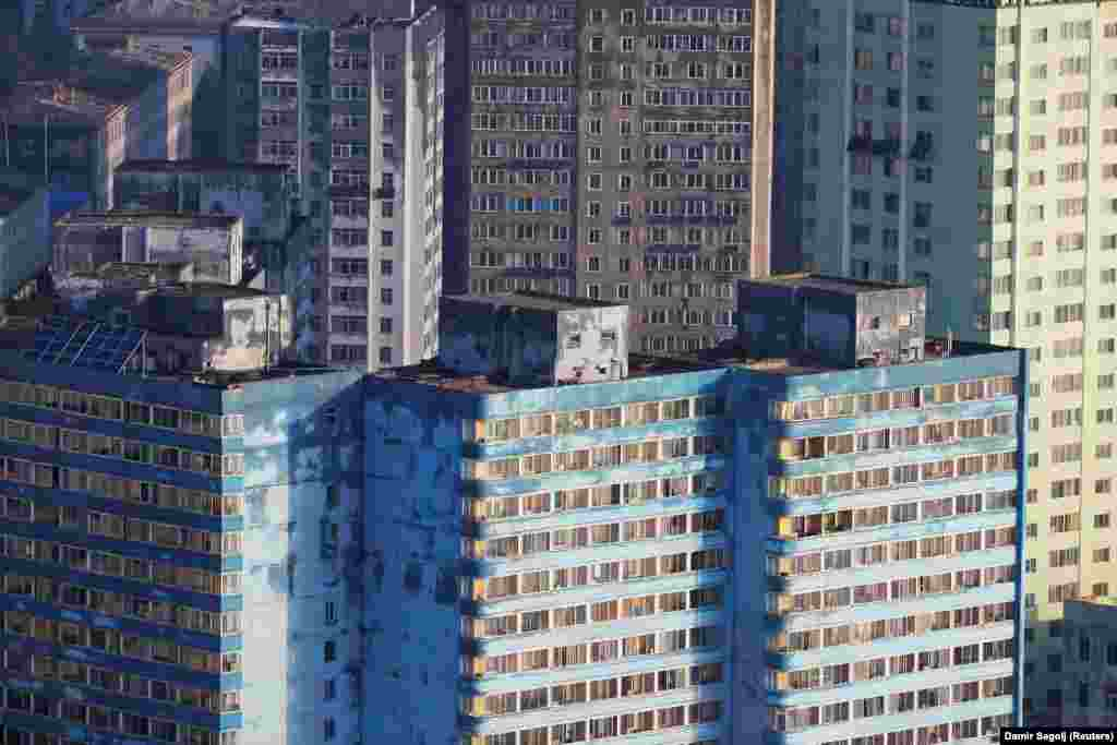 Decaying apartment blocks in Pyongyang. According to a report in The Guardian, many North Koreans rely on illicit trade to feed their families.