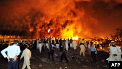 Flames rise from the Marriott hotel following a powerful bomb blast in Islamabad in 2008.