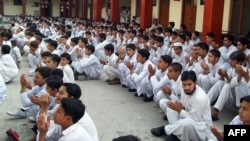 Students pray for the early recovery of Malala Yousafzai at a government school in Mingora, the main town of the northwestern Swat Valley.