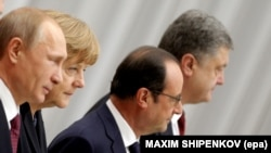 Russia's Vladimir Putin, Germany's Angela Merkel, France's Francois Hollande, and Ukraine's Petro Poroshenko at peace talks in Minsk on February 11.