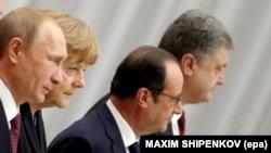 Учасники саміту в «нормандському форматі» (л-п) Володимир Путін, Анґела Меркель, Франсуа Олланд, Петро Порошенко, Мінськ, 11 лютого 2015 року