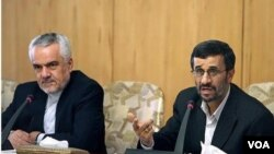 Iranian President Mahmud Ahmadinejad (right) attends a conference with his first vice president, Mohammad Reza Rahimi.