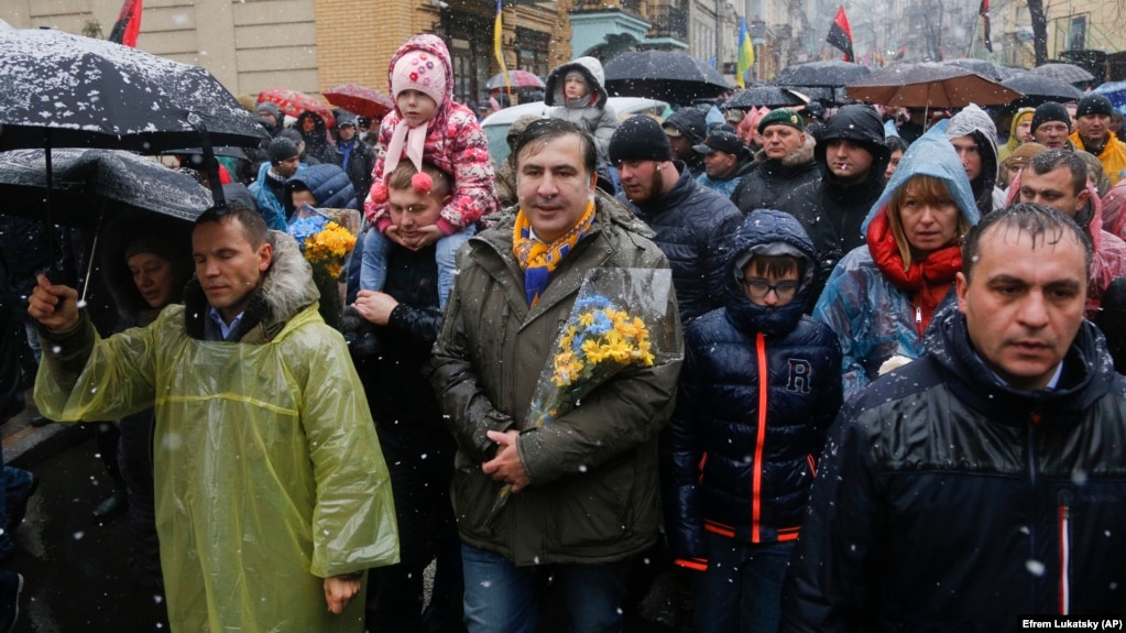 Mikheil Saakashvili (center) marches with supporters central Kyiv on November 12.