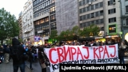 People protest against the rule of Serbian Prime Minister Aleksandar Vucic in Belgrade on April 19