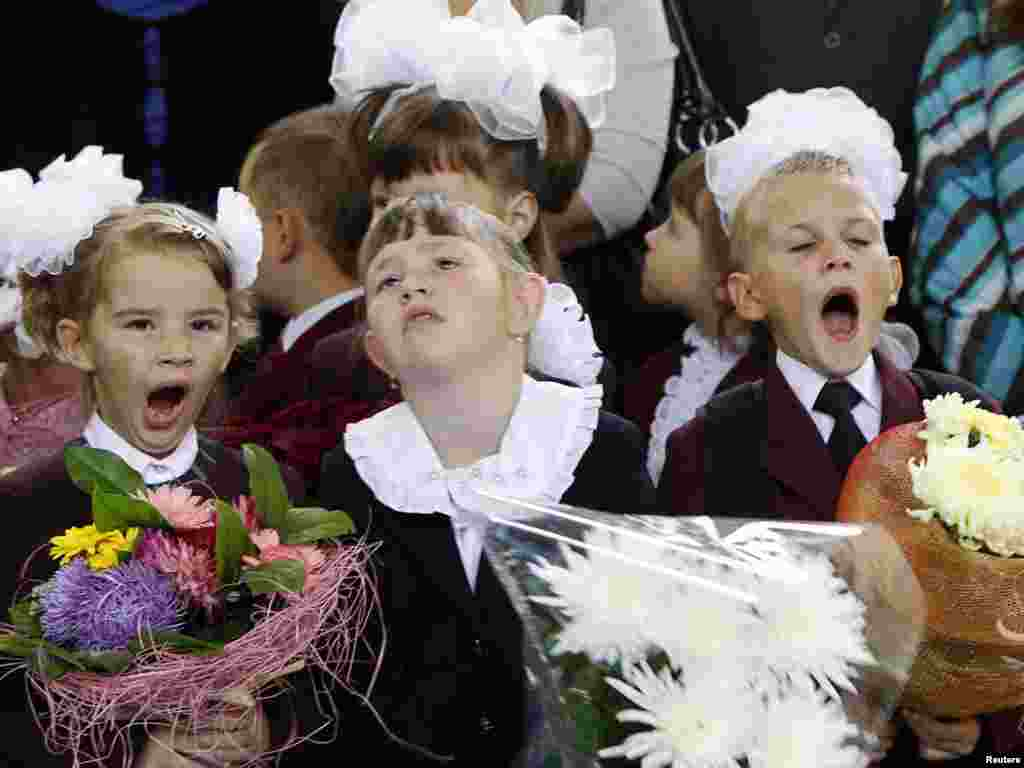 First graders yawn as they take part in a festive ceremony to mark the start of another school year in Kyiv on September 1.Photo by Gleb Garanich for Reuters