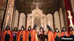 Armenia - Catholicos Garegin II (C) and other high-ranking clerics of the Armenian Apostolic Church hold a religious service.