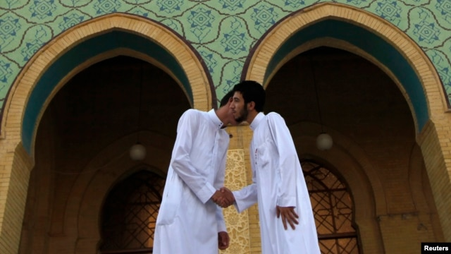 Sunni worshipers exchange greetings after their Eid Al-Fitr prayers to mark the end of the Muslim holy fasting month of Ramadan at a Sunni mosque in Baghdad in August.