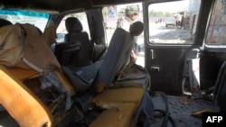 Взорванный в Багдаде автомобиль. 13 марта 2014 года.