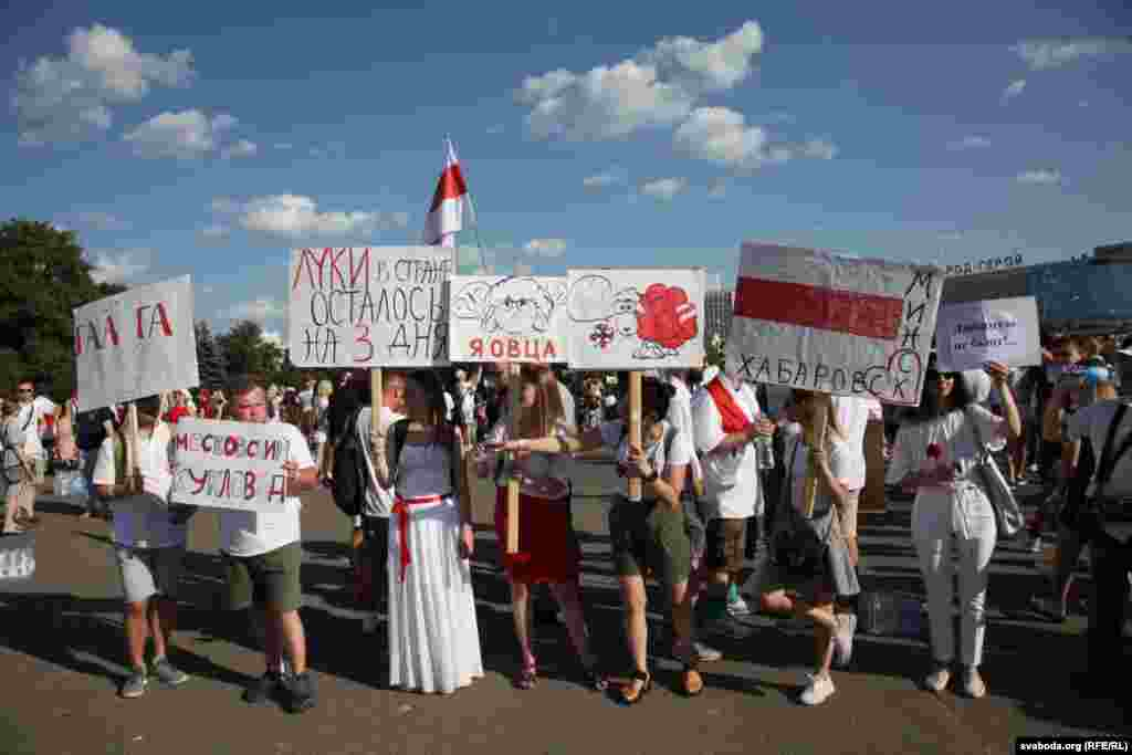 "Shortly after the August 9 election in which many potential candidates were blocked from running, Lukashenka called anti-government demonstrators ""sheep"" organized by ""puppeteers"" from abroad. At a March For Freedom in Minsk, a woman (center) holds a sign that reads: ""I am a sheep."""
