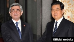 Armenia -- President Serzh Sarkisian and his Chinese counterpart, Hu Jintao, meet in Shanghai, 3 May 2010.