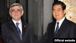 Armenian President Serzh Sarkisian (left) and his Chinese counterpart, Hu Jintao, meet in Shanghai on May 3.