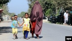 An Afghan family leaves Kunduz following clashes between Taliban and Afghan security forces.