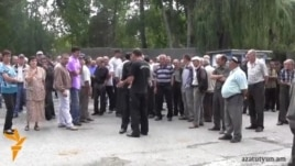 Armenia - Workers of a cement plant in Hrazdan go on strike to demand their back wages, 5Aug2014.