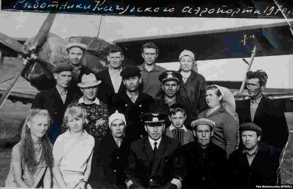 Vladimir (center front) with airfield staff in his piloting days. In the background is one of the Soviet AN-2 biplanes that serviced Prokopyev's airport. He finished his career flying the Tupolev TU-104, one of the world's first passenger jets.