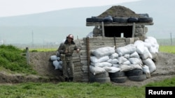 Nagorno-Karabakh -- An ethnic Armenian soldier stands guard at a checkpoint near Nagorno-Karabakh's town of Martuni, April 8, 2016