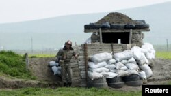 Nagorno-Karabakh -- An Armenian soldier stands guard at the checkpoint near Nagorno-Karabakh's town of Martuni, April 8, 2016