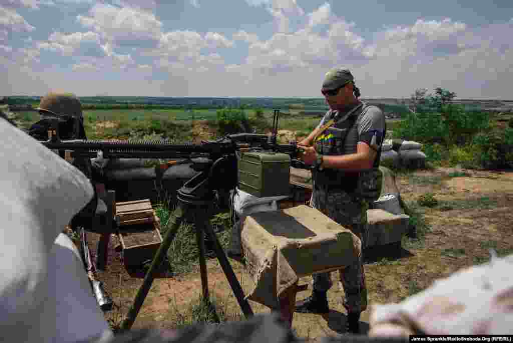 A soldier of the Ukrainian Army's 17th battalion readies a DShKM antiaircraft gun near the town of Dzerzhynsk.