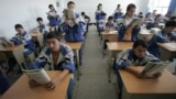 CHINA -- Students read from their textbooks in a classroom at a bilingual middle school for ethnic-Uighur Muslim and Han Chinese students in Hotan, 13 October 2006, in China's far northwest Xinjiang Uighur Autonomous Region in Central Asia. I