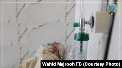 آرشیف، یک بیمار مبتلا به ویروس کرونا در شفاخانه افغان جاپان در کابل