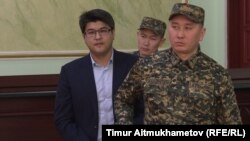 Former Kazakh Economy Minister Quandyq Bishimbaev at his trial in Astana on January 8.
