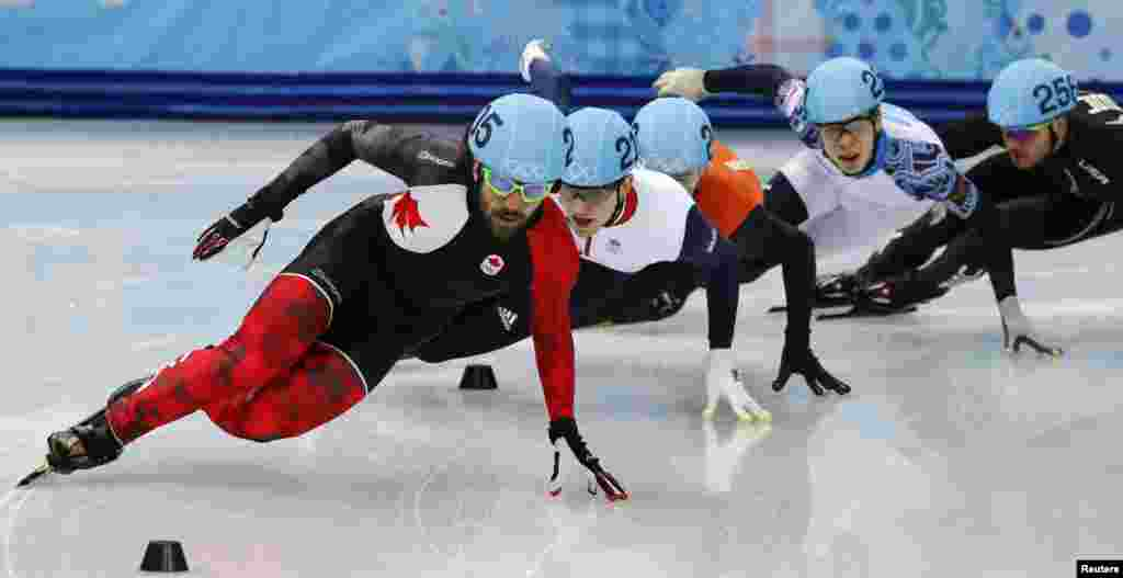 Canada's Charles Hamelin (left) leads during the men's 1,500-meters short-track speed-skating semifinals event at the Iceberg Skating Palace. Hamelin won gold.