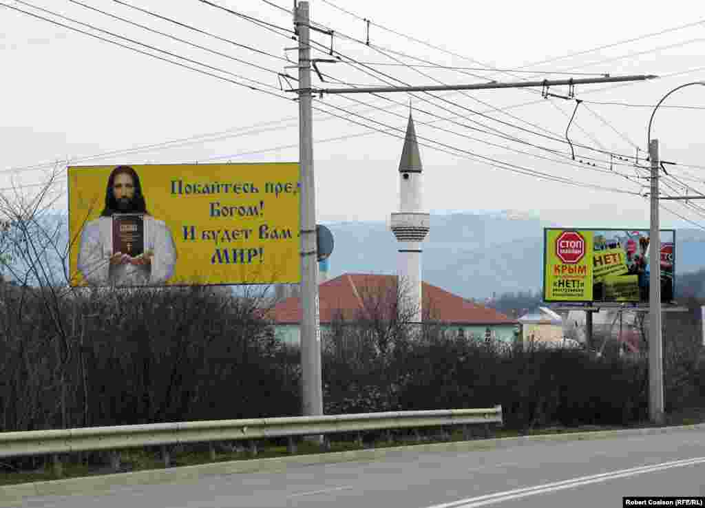 A Christian message, a mosque, and an anti-Maidan billboard ('No to foreign interference!') on the road from Simferopol to Yalta.