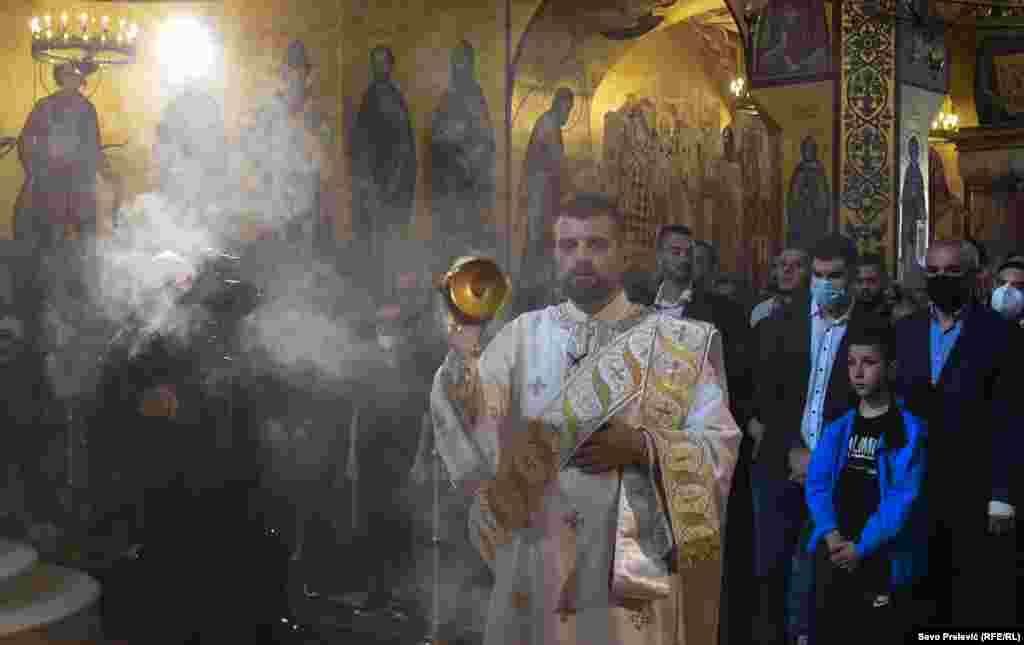 Clergy at the Metropolitan of the Serbian Orthodox Church in Montenegro perform the Easter liturgy in the Church of Christ's Resurrection in Podgorica on May 2. They used one teaspoon to share communion among the congregation, violating prescribed COVID-19 measures.