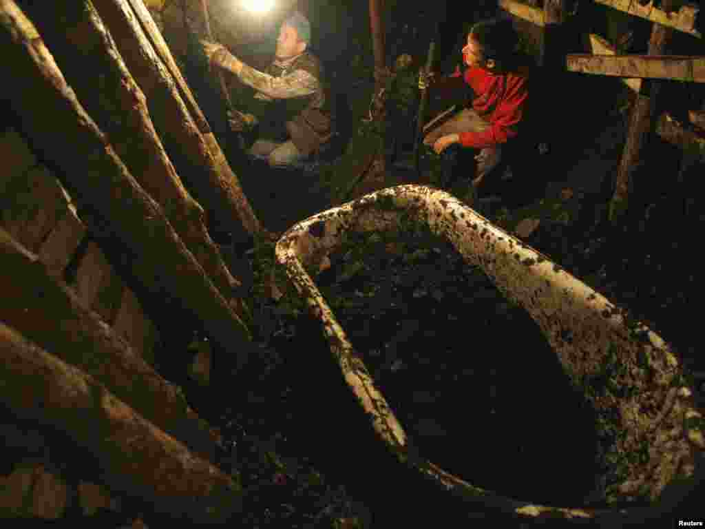 Illegal miners dig coal in the village of Stranjani, near Zenica, on October 26. There are about 20 illegal mines in the area, where Bosnians dig for coal with their bare hands and use primitive tools such as bathtubs to transport the coal. Photo by Dado Ruvic for Reuters