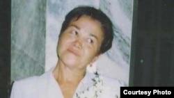 Фотография погибшей в тюрьме корреспондентки Туркменской редакции Радио «Свободная Европа»/Радио «Свобода» Огулсапар Мурадовой была сделана в 2004 году на свадьбе ее сына в Ашгабате.