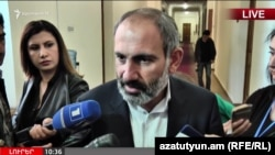 Opposition leader Nikol Pashinian talks to journalists in Yerevan on April 30.