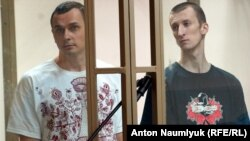 Ukrainian filmmaker Oleh Sentsov (left) and his co-defendant Oleksandr Kolchenko on trial in a Russian court in 2015.
