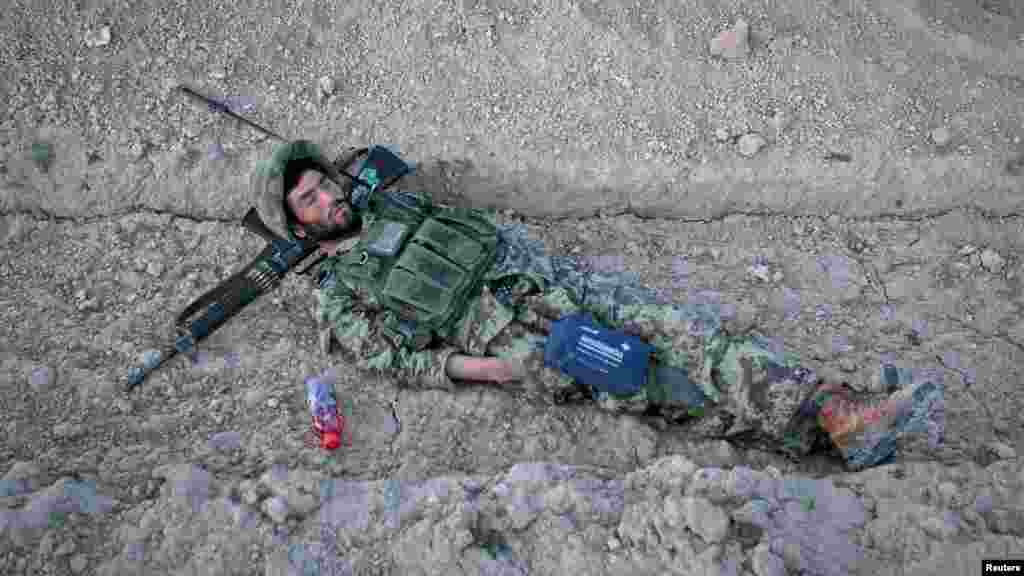 An Afghan National Army (ANA) soldier takes a nap before an early morning joint patrol with U.S. soldiers in a village in Logar Province on May 22. (Reuters/Danish Siddiqui)