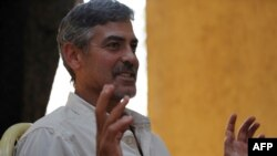 """American actor George Clooney speaks about south Sudan's secession referendum during an interview with AFP in Juba on the eve of the vote. Clooney, who spearheaded the initiative, has described the satellite cameras as """"antigenocide paparazzi."""""""