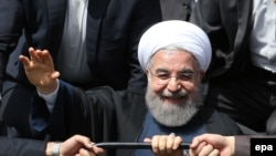 Iranian President Hassan Rohani greets supporters in the southeastern city of Kerman last month. Some have suggested the publication of the pay slips is an attack on him ahead of next year's presidential election.