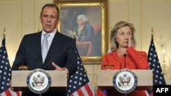 Sergey Lavrov və Hillary Clinton