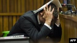 Оскар Пісторіус у залі суду в місті Преторія, Південноафриканська республіка, 13 березня 2014 року
