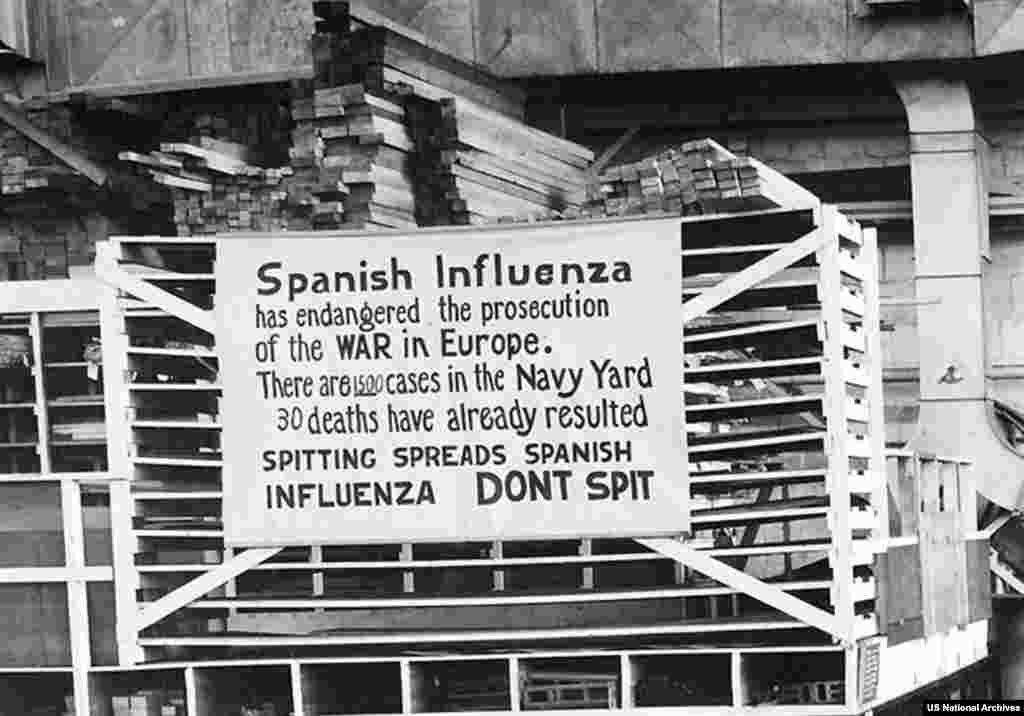 "An ""anti-spitting"" sign in a U.S. Navy yard in 1918.   As the virus began to spread, it was dubbed the ""Spanish Influenza"" for the sole reason that most European countries had muzzled their news media to control the flow of information during the war. Since Spain was neutral and its media free at the time, the first reports of the lethal new illness emerged from there."