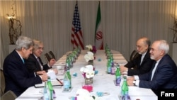 Iran's Foreign Minister Mohammad Javad Zarif (right) and the head of the Atomic Energy Organization of Iran, Ali Akbar Salehi, meet with U.S. Secretary of State John Kerry (left) and U.S. Energy Secretary Ernest Moniz in Geneva.