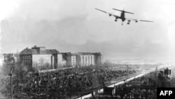 A U.S. transport aircraft flies over Berlin's Tempelhof Airport in June 1948