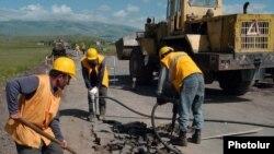 Armenia -- Workers repair a rural road, undated.