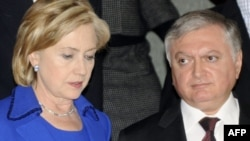 U.S. Secretary of State Hillary Clinton speaks with Armenian Foreign Minister Eduard Nalbandian after the signing ceremony on October 10