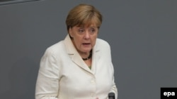 Ангела Меркель выступает в Бундестаге 28 июня.